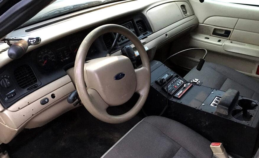 Politie auto kopen Ford Crown V8
